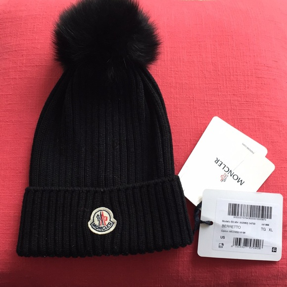 a0525e48d463a Moncler Ribbed-Knit Beanie Hat with Fur Pompom. M 5ac6602c46aa7c5ce5a79fc7.  Other Accessories ...
